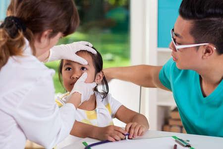 Asian little girl during eye examination, horizontal