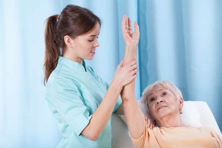 Closeup of arm rehabilitation on treatment couch