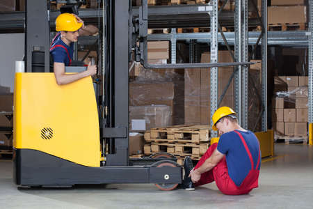 Horizontal view of a forklift accident in storehouse