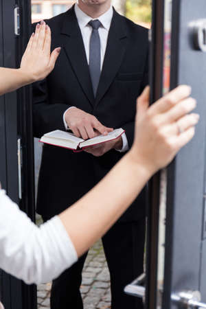 Woman talking Jehovah's witness to leave her house