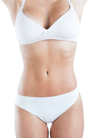 Close-up of slim woman body with flat abdomen
