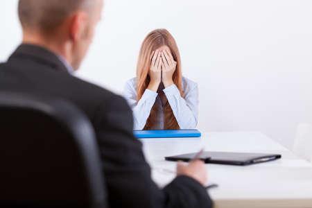 Broken girl during an interview in office