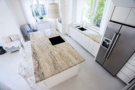 Photo for Big granitic worktop in bright kitchen, vertical - Royalty Free Image