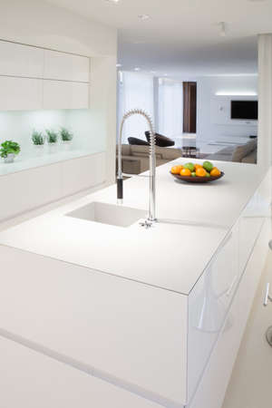 Foto de Kitchen island inside elegant and expensive house - Imagen libre de derechos