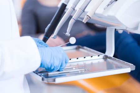 Photo for Close-up of dentist's hands and dental equipment - Royalty Free Image