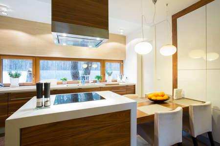 Foto de Furnished and cozy kitchen in modern house - Imagen libre de derechos