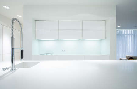Horizontal view of simple white kitchen interior