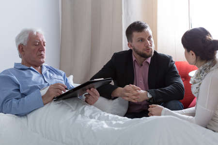 Image of terminally ill father making a will