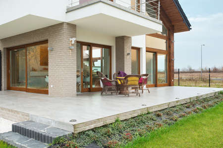 Big modern residence with marble porch