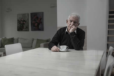 Senior sad lonely man and his coffee time