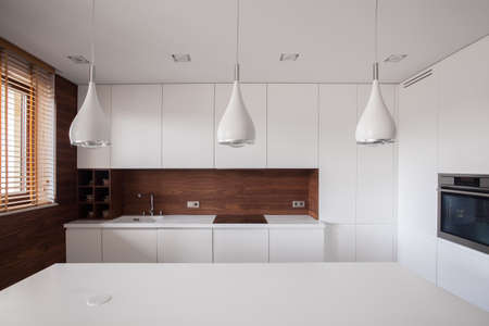 Photo for Beauty white traditional kitchen with wooden details - Royalty Free Image