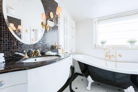 Image of new fashionable baroque style bathroom