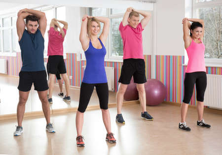 Fitness group exercising together at the gym