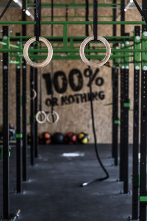 Photo of crossfit zone with gymnastic circles on gym