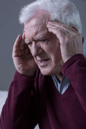Elderly men having horrible migraine