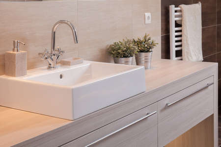 Close-up of white porcelain square basin in new bathroom