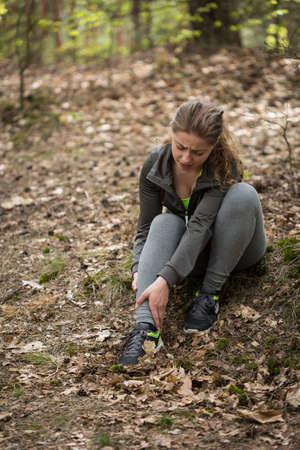 Image of female jogger having ankle sprain