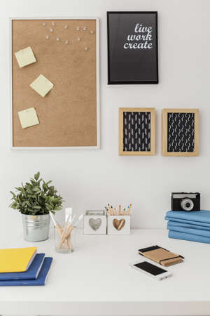 Well organized materials on white desk in office