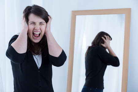 Image of young woman with problems shouting loudly