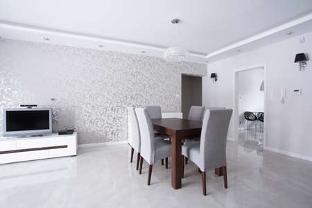 Bright interior with silver walls and wooden table