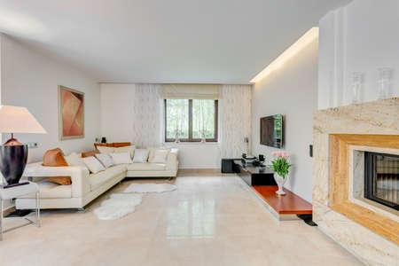Cream corner sofa in spacious drawing room