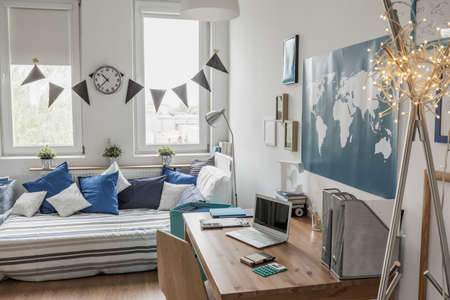 Stylish modern white room with blue details