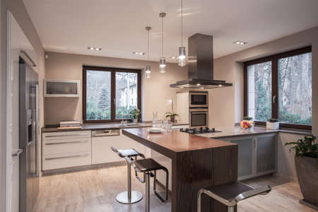 Photo for Interior of designed kitchen in modern house - Royalty Free Image