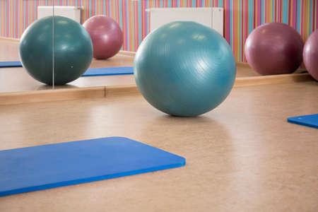 Interior of pilates room with equipment, horizontal