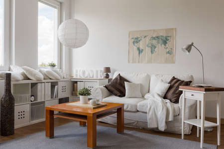Interior of modern drawing room in white