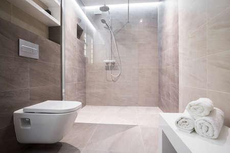 Shower with glass door in exclusive bathroom