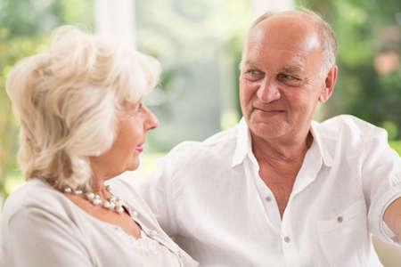 Horizontal view of happy senior couple talking
