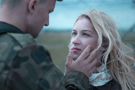Soldier saying goodbye to beauty upset wife