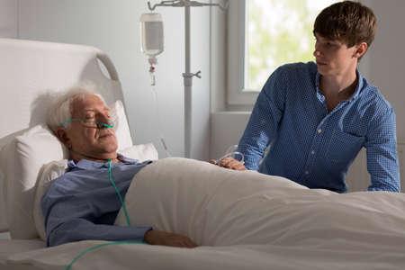 Terminally ill senior man staying in hospital
