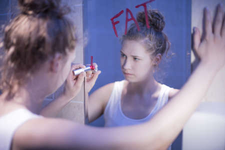 Photo for Image of slim frustrated girl thinking she is fat - Royalty Free Image