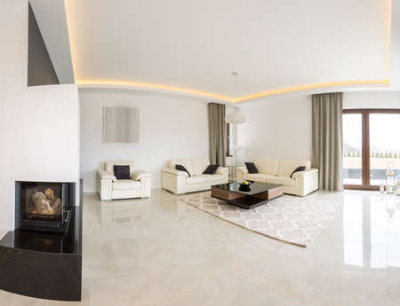 Spacious bright living room with fireplace and marble floor