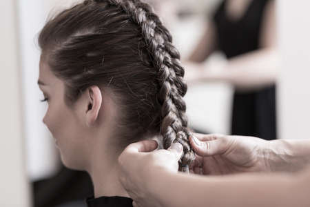 Close-up of hairdresser doing beautiful wedding hairstyle