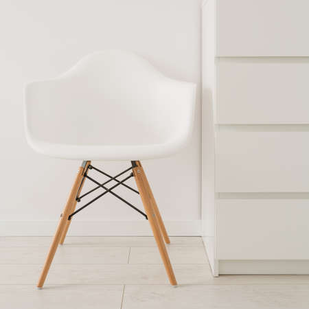 Close-up of white chair in modern design