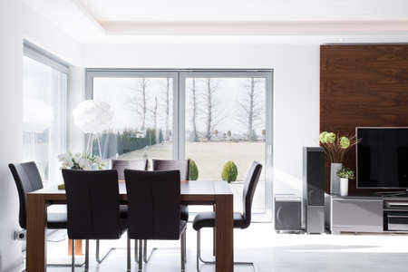Photo for Interior of minimalistic modern bright dining room - Royalty Free Image