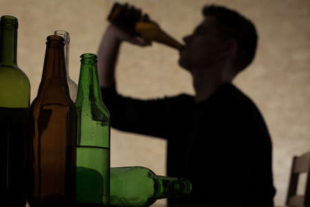 Photo for Alcoholism among young people - teenager drinking beer - Royalty Free Image