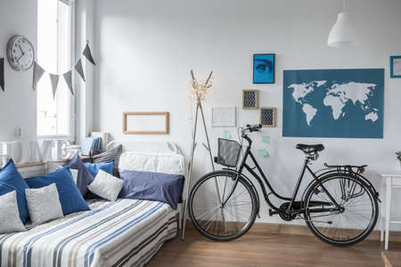 Urban bike standing in designed teenager room