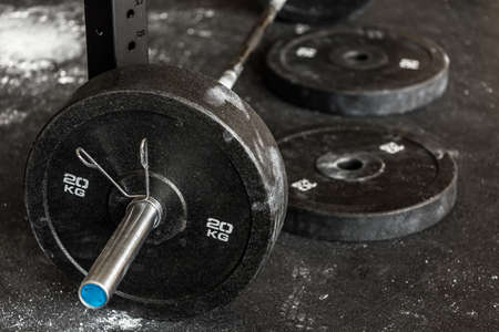 Close-up of heavy barbell on the gym floor
