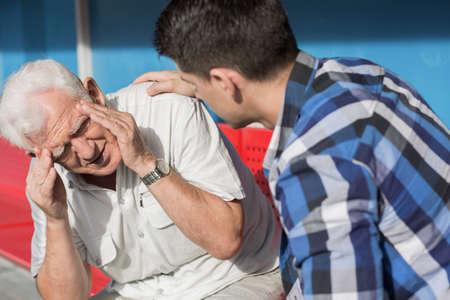 Image of senior man suffering from dizziness