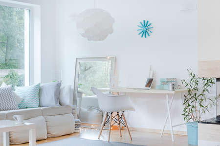 Picture of sunny sophisticated studio room design