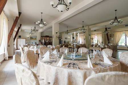 Photo Of Elegant Dining Room With Round Tables