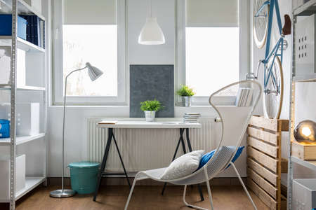 Small bright studio flat with white furniture
