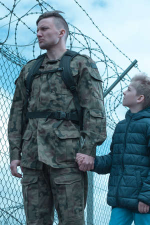 Soldier leaving for army is accompanied to base by son