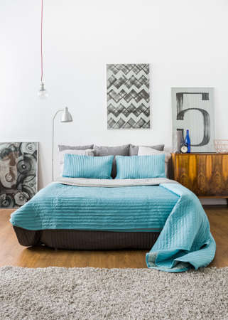 Photo pour Image of contemporary stylish interior with comfortable bed - image libre de droit