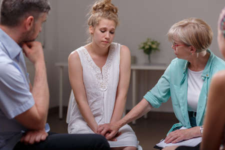Image of domestic violence victim on therapy with support group