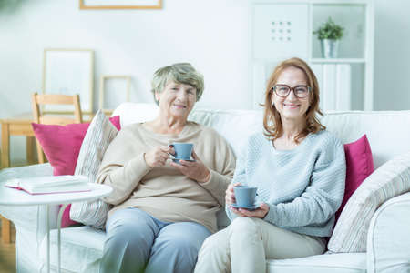 Foto per Middle-aged woman spending time with her elderly mother - Immagine Royalty Free
