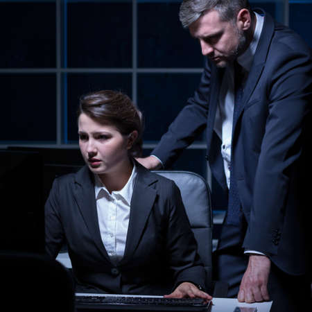 Woman and man have hard night in office